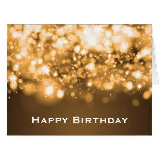 Oro chispeante de las luces del cumpleaños tarjeta