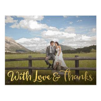 Oro con la postal de la foto del amor y de las
