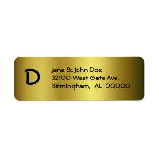 Oro con las etiquetas de dirección del monograma