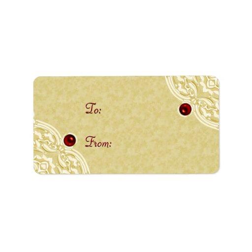 Oro con las etiquetas rojas del regalo de vacacion etiquetas de dirección