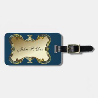 Oro con monograma y etiqueta azul del equipaje