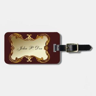 Oro con monograma y etiqueta marrón del equipaje