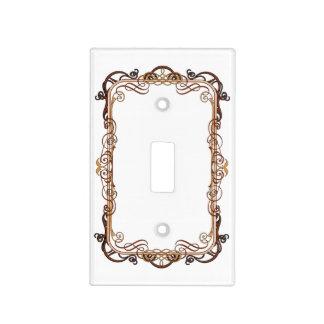 oro decorativo del marco en la cubierta de interru placas para interruptor
