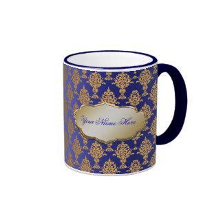 Oro del damasco en azul real taza de dos colores
