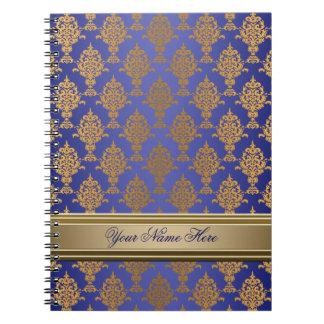 Oro del damasco en brillo del azul real libros de apuntes