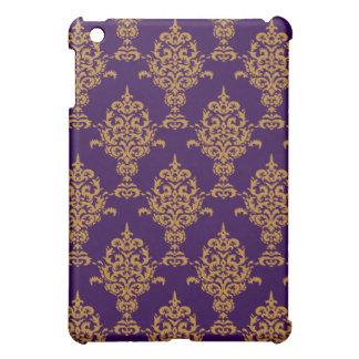 Oro del damasco en ed púrpura