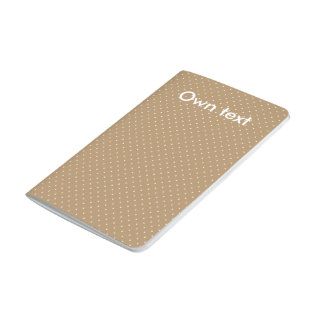 Oro del diario del bolsillo con los puntos blancos cuaderno grapado