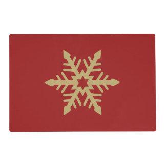 Oro del diseño del copo de nieve en rojo tapete individual