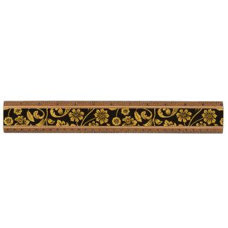 Oro del efecto del brillo floral en negro regla de arce