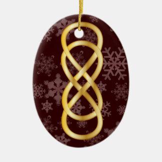 Oro doble del infinito, copos de nieve, en de adorno ovalado de cerámica