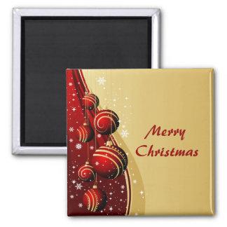 Oro e imán rojo de las bolas del navidad