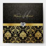 Oro elegante y sobres negros del damasco