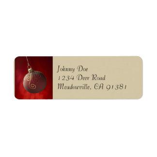 Oro en la etiqueta roja de Avery del ornamento