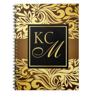 Oro floral adornado del diario el | del monograma note book