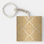 Oro grabado en relieve mirando el modelo del damas llavero