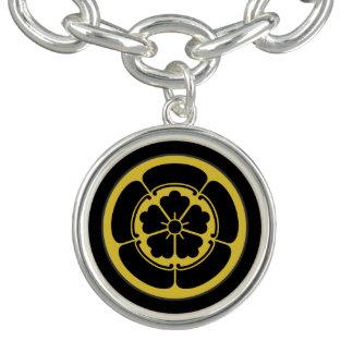 Oro japonés del clan del samurai del Oda lunes en Pulsera Con Dije