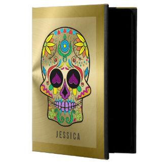 Oro metálico con el cráneo colorido del azúcar
