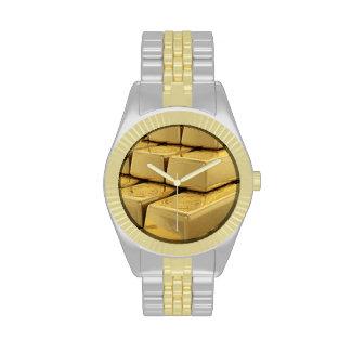 oro reloj de mano