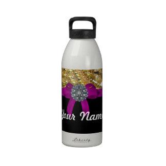 Oro reluciente y negro botella de beber