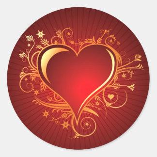 Oro rojo afiligranado radiante del corazón el | pegatina redonda