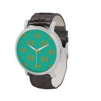 Oro sobre el damasco brillante de la turquesa reloj de mano