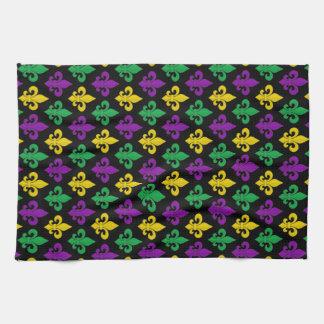 Oro verde del carnaval y flor de lis púrpura toalla de cocina