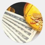 Oro y efectivo pegatina redonda