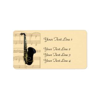 Oro y etiquetas negras de la partitura del saxofón etiquetas de dirección