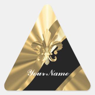 Oro y flor de lis negra pegatina triangular