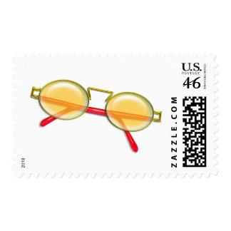Oro y gafas de sol rojas del borde del alambre