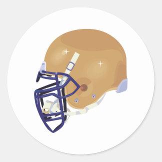 oro y gráfico de vector azul del casco de fútbol pegatina redonda