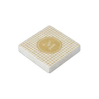 Oro y guinga blanca su monograma