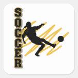 Oro y jugador de fútbol de la hembra del negro calcomanías cuadradases
