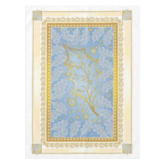 Oro y mantel helado plata de las hojas del acebo