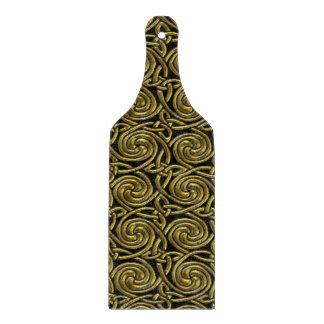 Oro y modelo de nudos espiral céltico del negro tabla para cortar