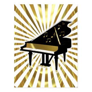 Oro y notas negras de la música del piano de cola postales