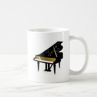 Oro y notas negras de la música del piano de cola tazas de café