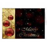Oro y ornamentos rojos del navidad del centelleo felicitaciones