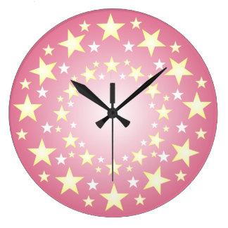 Oro y reloj de pared rosado del modelo de estrella