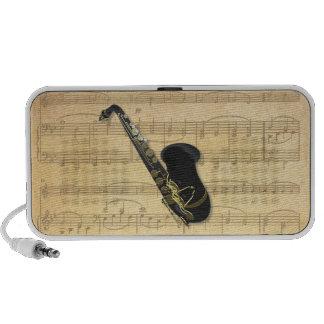 Oro y saxofón negro en viejo Doodle de la partitur Altavoces