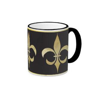 Oro y taza negra de la flor de lis
