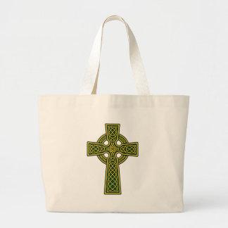 Oro y verde de la cruz céltica bolsas de mano