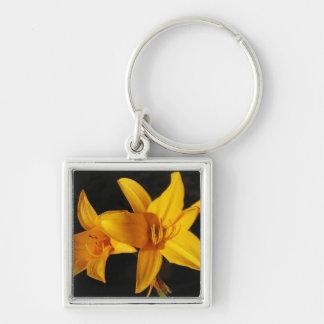 Orquídea amarilla llavero cuadrado plateado
