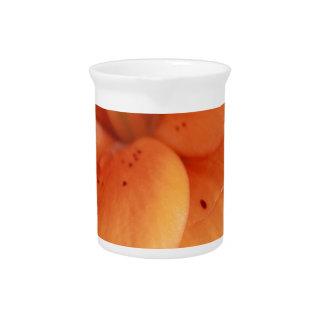 Orquídea anaranjada jarra de beber