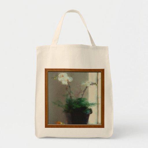Orquídea de polilla en ventana bolsa de mano