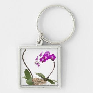 Orquídea llena del marco aislada en un fondo blanc llavero cuadrado plateado