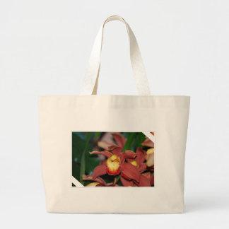 Orquídea roja y amarilla bolsa