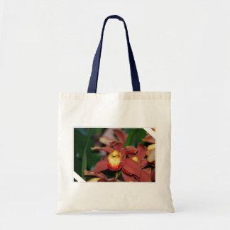 Orquídea roja y amarilla bolsa de mano