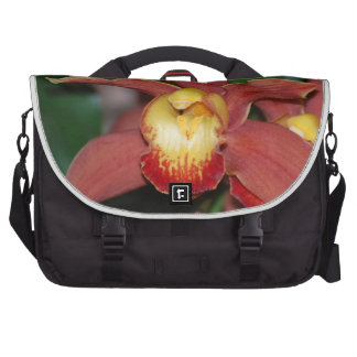 Orquídea roja y amarilla bolsas de portátil