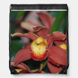Orquídea roja y amarilla mochila